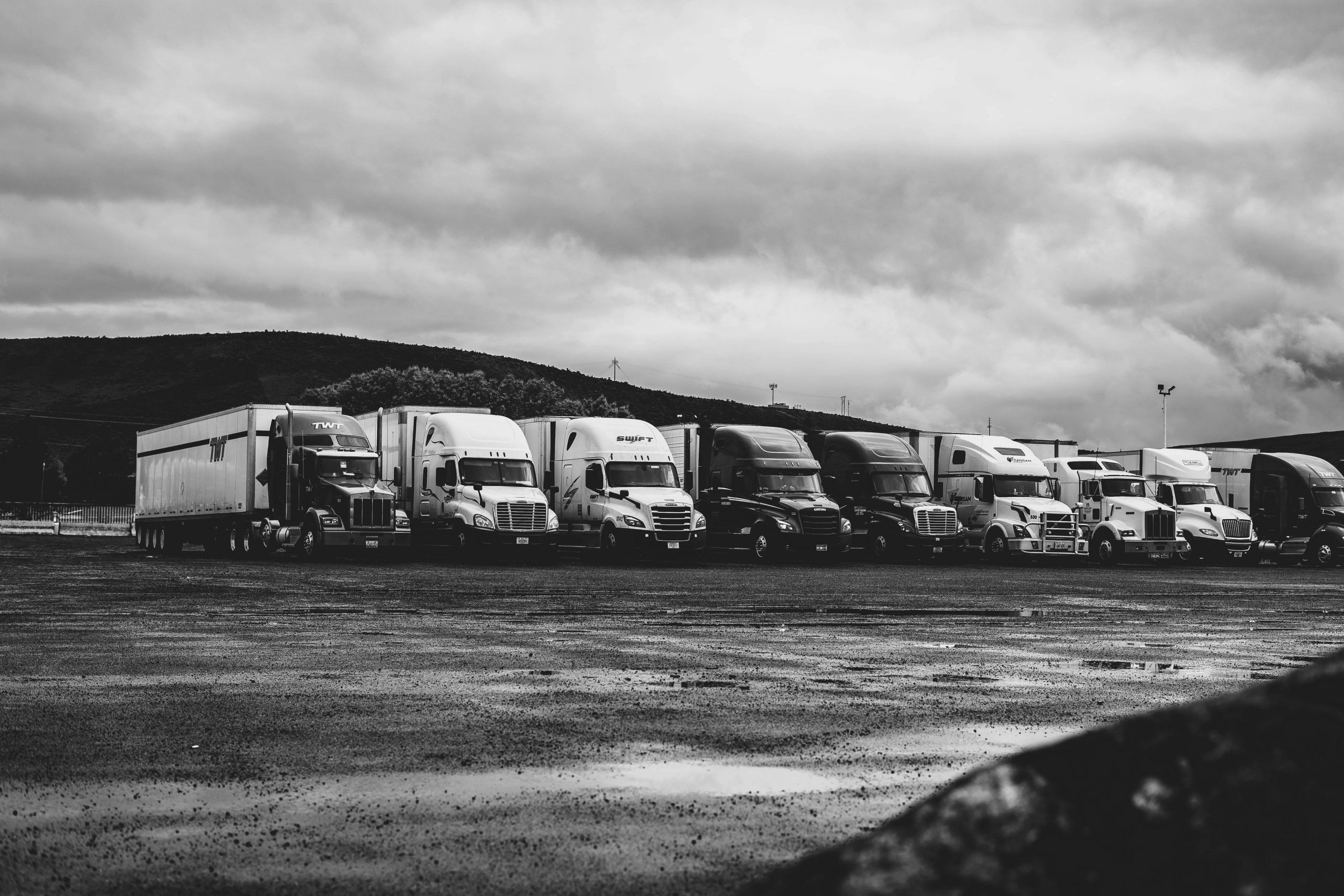 parked-trucks-under-clouds-2348359-min